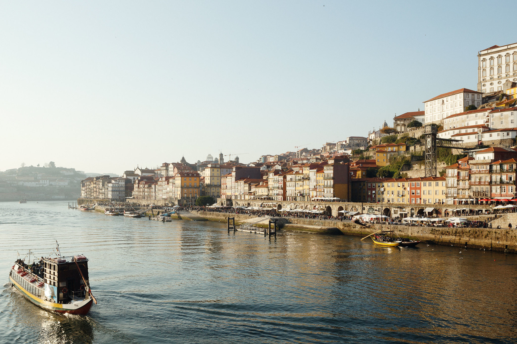 Porto's historic district of Ribeira is known for its riverside restaurants and bars